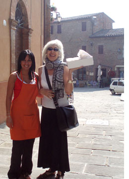 Kiki and Fabiola in Panicale's Piazza with some Italian cappucchino to go