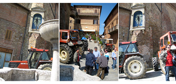 tractors in the piazza for labor day in panicale in umbria, italy