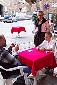 Playing Italian card games in the piazza of Panicale, Umbria